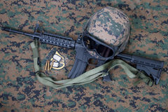 M4 carbine, kevlar helm with goggles and blank dog tags on us marines camouflage uniform Royalty Free Stock Photography