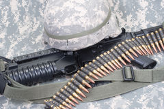 M4 carbine, kevlar helm and us army camouflage uniform Royalty Free Stock Image