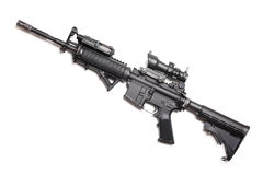M4A1 carbine without magazine. M4A1 (AR-15) 14,5 carbine with ACOG sniper sight, AN/PEQ15 and AFG tactical grip. Studio shot Stock Images