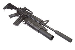 M4 carbine with silencer equipped with an M203 grenade launcher Stock Photo