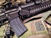 M4A1 carbine on tactical vest Stock Photo