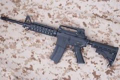 M4 carbine on us marines camouflage uniform Stock Image