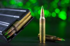 M855 cartridges and magazine with green background Stock Images