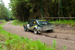 M. Conlon driving Ford Escort Royalty Free Stock Images