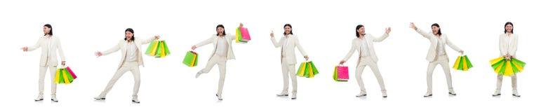M??czyzna z torba na zakupy odizolowywaj?cymi na bielu obrazy stock
