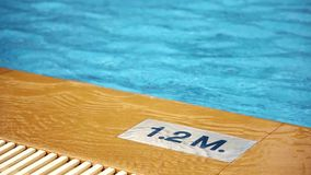 1.2 M. Depth marking on pool edge.inscription of the swimming pool depth.pool depth sign stock video