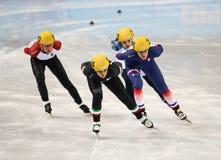 1000 m des dames chauffent la voie courte chauffent Image stock