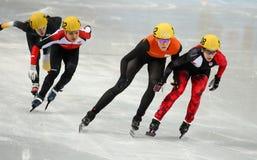 1000 m des dames chauffent la voie courte chauffent Photo stock