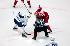 M. Ellison (10) and A. Nikulin (36) on faceoff. PODOLSK - OCTOBER 30, 2016: M. Ellison (10) and A. Nikulin (36) on faceoff on hockey game Vityaz vs Dynamo Minsk Royalty Free Stock Images