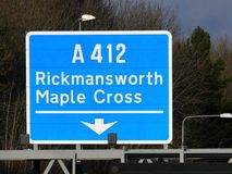 M25 exit sign at Junction 17 for Rickmansworth and Maple Cross A412 royalty free stock image