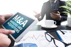 M&A (FUSIONEN UND ERWERB) stockfoto