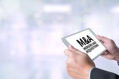 M&A (FUSIONEN UND ERWERB) stockfotografie