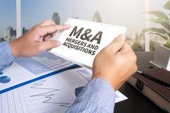 M&A (FUSIONES Y ADQUISICIONES) Foto de archivo libre de regalías