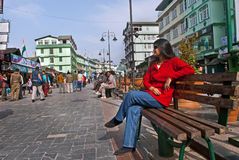 M G Marg, Gangtok. Local people enjoying a sunny morning at Mahatma Gandhi Marg, the main business and tourism centre of Gangtok, Sikkim, India Royalty Free Stock Images