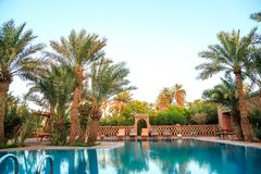 M'hamid, Morocco - February 22, 2016: panoramic view of pool in Chez le Pacha hotel. With typical decoration and palm tree around stock photos