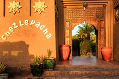 M'hamid, Morocco - February 22, 2016: Chez le Pacha hotel front door outside view. M'hamid, Morocco - February 22, 2016: typical arabic style front door outside royalty free stock photography
