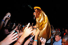 M.I.A., a rapper named Mathangi Maya Arulpragasam, surrounded by fans during her performance at FIB Festival Royalty Free Stock Image