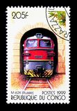 M-62K (Russia), Electric locomotives serie, circa 1999. MOSCOW, RUSSIA - NOVEMBER 25, 2017: A stamp printed in Congo shows M-62K (Russia), Electric royalty free stock photography