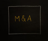 M & A letters (or Merger and Acquisition) on black background. Stock Images