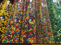 M&M. Bright colored M&Ms of different sizes in columns Stock Image