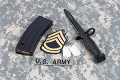 M-16 magazine with ammo and ba. Yonet on camouflage US Army uniforms Stock Photo