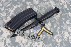M-16 magazine with ammo and ba. Yonet on camouflage US Army uniforms Stock Image