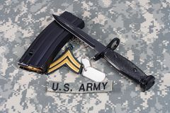 M-16 magazine with ammo and ba. M-16 magazine with ammo and bayonet on camouflage US Army uniforms Stock Photos