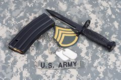 M-16 magazine with ammo and ba. Yonet on camouflage US Army uniforms Royalty Free Stock Photos