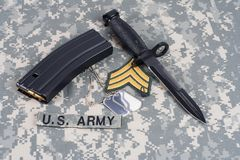 M-16 magazine with ammo and ba. Yonet on camouflage US Army uniforms Royalty Free Stock Photography