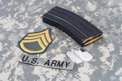 M-16 magazine with ammo on cam. Ouflage US Army uniform Royalty Free Stock Photography