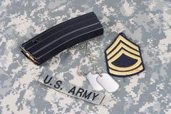 M-16 magazine with ammo on cam. Ouflage US Army uniform Royalty Free Stock Image