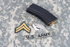 M-16 magazine with ammo on cam. Ouflage US Army uniform Royalty Free Stock Images