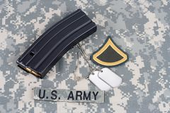 M-16 magazine with ammo on cam. Ouflage US Army uniform Stock Photography
