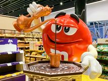 M&M mascot figure pouring Turkish coffee in a mug. Adaption of candy advertising of the company MARS for different regions and. Countries. Istanbul, Turkey royalty free stock photos