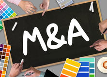 M&A (MERGERS AND ACQUISITIONS) , Businessman working at office royalty free stock images
