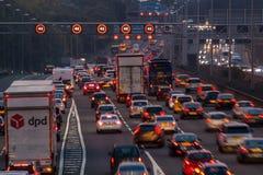 M1 motorway at dusk. Watford, UK - September 24, 2017: Evening traffic jam on British motorway M1.M25/M1 junction stock photos