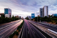M30 motorway in Madrid at sunset, long exposure. M30 motorway in Madrid at sunset. Long exposure with traffic light trails royalty free stock photos