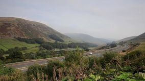 The M6 Motorway Timelapse. The M6 motorway alongside the west coast main line railway passes through the Howgill Fells in Cumbria, northern England. A low stock video