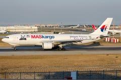 9M-MUD Maskargo, Airbus A330-223F com Panda Sticker Imagens de Stock