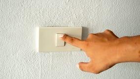M?o com o dedo no interruptor da luz imagens de stock royalty free