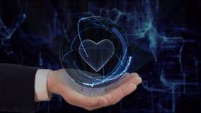 A m?o pintada mostra o cora??o do holograma do conceito em sua m?o imagem de stock