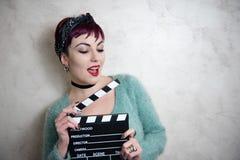 Młoda alternatywna dziewczyny twarz z filmu clapper Fotografia Stock