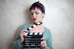 Młoda alternatywna dziewczyny twarz z filmu clapper Zdjęcie Stock