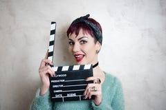 Młoda alternatywna dziewczyny twarz z filmu clapper Obrazy Stock
