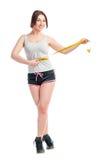 Młoda dziewczyna mierzy jej talia centymetr Zdjęcia Royalty Free