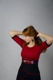 Młoda dziewczyna w czerwonej sukni Obraz Royalty Free