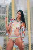 Młoda dziewczyna w kolii i swimsuit Fotografia Stock