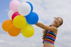 Młoda dziewczyna z balonami Obraz Stock
