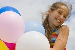 Młoda dziewczyna z balonami Fotografia Royalty Free