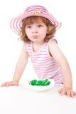 Młoda dziewczyna z zielonymi candys Obrazy Royalty Free